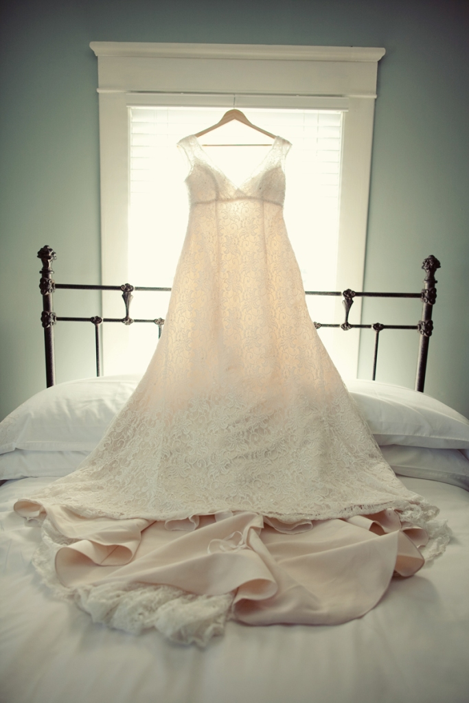 ivory-wedding-dress-on-bed-korie-lynn-photography